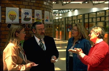 Colombia: Jewish schoolteachers schmooze at Bogotá's Colegio Colombo-Hebreo. An estimated 4,200 Jews live in Colombia, down from over 10,000 in the 1970s. PHOTO BY LARRY LUXNER.