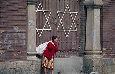 Colombia: Local woman walks past entrance to Jewish cemetery in Bogotá.  PHOTO BY LARRY LUXNER.
