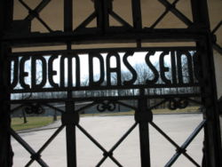 "Gate with the words Jedem das Seine (literally, ""to each his own"", but figuratively ""everyone gets what he deserves"")"