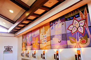 he sanctuary of Congregation Sha'are Zedeck in San Juan, Puerto Rico, features tapestries of the 12 Tribes of Israel. Photo by Larry Luxner. With permission.